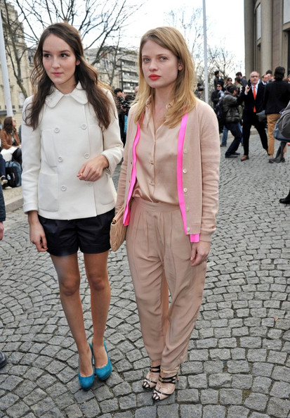 Melanie wears loose rayon pleated harem pants in a soft sand hue for the Miu Miu show in Paris.