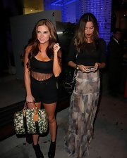Brittany Binger's Louis Vuitton tote was a luxurious complement to her seductive attire.
