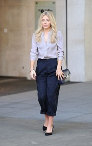 Mollie King was spotted outside the BBC Studios wearing a casual yet cute gray button-down shirt.