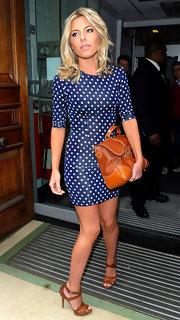 Mollie King paired tan strappy leather sandals with her two-tone leather satchel while out in London.