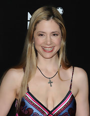 Mira Sorvino kept her look simple with a long straight 'do.