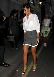 Frankie Sandford chose a black and white checkered skirt with zippers for her LFW look.
