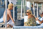 "Even while vacationing in Saint Tropez Kate doesn't leave home without her handy ""Birkin"". There's nothing like getting sand on a bag that costs thousands of dollars, right?"