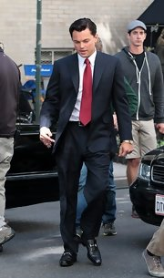 Leonardo DiCaprio filmed 'The Wolf of Wall Street' looking dapper in a suit and embellished black leather shoes.