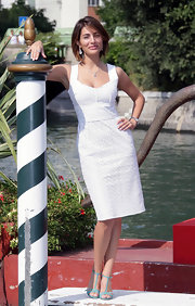 Caterina posed in her summery white eyelet dress at the Venice Film Festival.