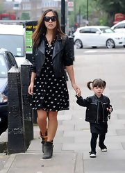 Myleene opted for a rocker leather jacket to pair over her printed frock.