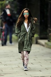 Myleene Klass almost look overpowered by this green utility jacket!