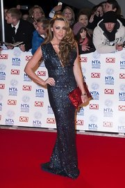 Michelle Heaton matched her glitter gown with a sparkly red clutch at the NTAs.