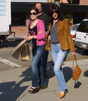 Lara Flynn Boyle went shopping in style in a tan suede jacket.