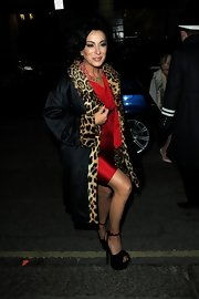 Nancy Dell'Olio showed her glamorous side with platform pumps and a satin evening coat with leopard print trim.