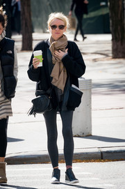 Naomi Watts went on a coffee run dressed down in gray leggings.