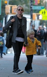 Naomi Watts kicked back with the family in velcro leather sneaks.