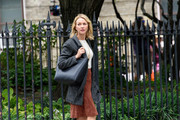 Naomi Watts went for a stroll carrying a black leather shopper bag.