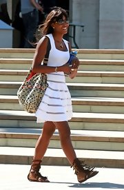Naomi looked ready for fashion week in a white sun dress and fringe gladiator sandals.