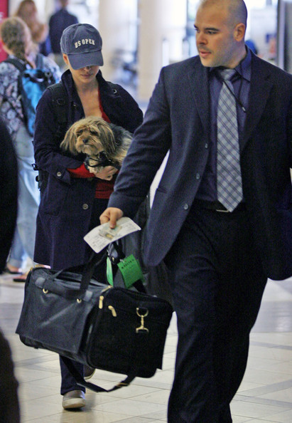 Natalie has a lucky dog... he's got more frequent flyer miles that we do.