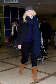 Natasha Bedingfield strode through LAX wearing a pair of slouchy brown boots.