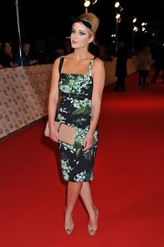 Helen Flanagan paid homage to retro style in a form-fitting print dress at the National Television Awards.