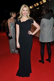 Holly Willoughby kept her red carpet look classic and simple with a column-style black gown with an asymmetrical neckline.