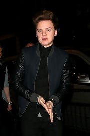 Conor Maynard opted for a cool zip-up jacket with leather sleeves for his going-out look in London.