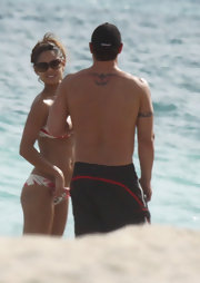 Nick has a red and black tribal tattoo across his back.
