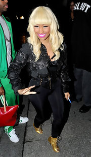 Nicki Minaj spiced up her monochromatic look with gold lace up booties with peep toes.