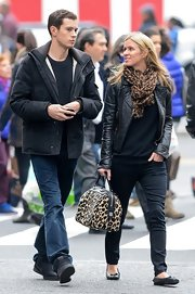 Nicky gave her laid-back look and exotic touch with a leopard-print bowler bag.