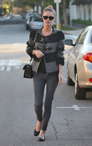 Nicky Hilton was chic in a striped black and gray sweater paired with skinny jeans and black flats.