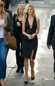 Nicola Peltz teamed her alluring dress with basic black platform pumps.