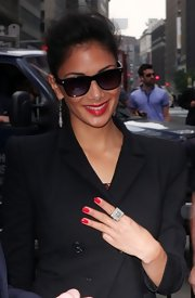 Nicole Sherzinger arrived for the opening bell at NASDAQ wearing classic red lips with matching nails.