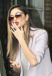 Nicole Scherzinger showed off her perfect plum mani while blowing kisses outside the ITV Studios.