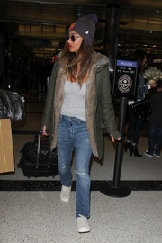 Nicole Scherzinger topped off her airport look with a fur-lined utility jacket.