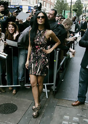 Nicole Scherzinger donned a mult-printed mini dress paired with daring beige and black wedges.