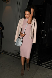 Nina Dobrev opted for a pair of brown suede ankle boots by Windsor Smith to finish off her outfit.