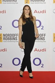 Mel C donned a basic black jumpsuit for the Nordoff Robbins O2 Silver Clef Awards.