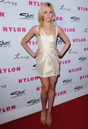 Brittany looked pure as snow at Nylon mag's anniversary fete, wearing a structured ivory mini dress with asymmetrical shoulder detail.