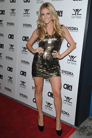 Casey showed off her flashy side in a metallic gold dress.