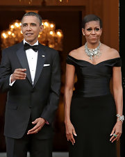 Michelle Obama went all out with the sparklies, matching a chunky diamond bracelet with her statement necklace.