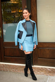 Olivia Munn commanded attention on the streets of New York City in a blue and black leather skirt suit Versace.