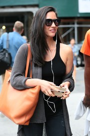 Olivia Munn stepped out in New York City wearing a pair of classic wayfarers.