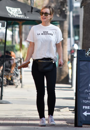 Olivia Wilde teamed a white Clare V. 'Vive La Resistance' tee with black skinny jeans for a day out in LA.