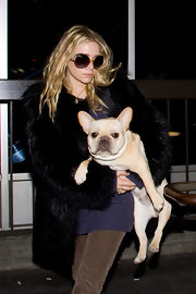 Ashley Olsen donned retro oversize sunglasses at LAX.