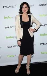 Lana Parrilla paired a classic little black dress with a modern cream and black blazer for a sleek updated look at PaleyFest.