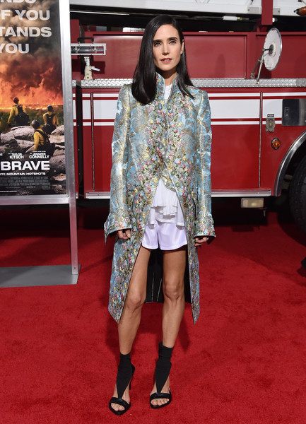 Jennifer Connelly elevated a pair of white shorts with a gorgeous printed and embroidered Louis Vuitton coat for the world premiere of 'Only the Brave.'