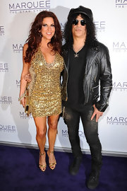 Slash wore a pair of patched black skinnies to the opening of Marquee Nightclub in Australia.