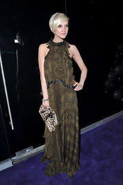 Ashlee Simpson looked elegant in this loose snake print dress at the opening of Marguee Night Club in Australia.