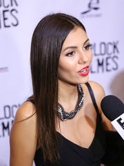 Victoria Justice stuck to her signature long center-parted style when she attended the opening of Sir Arthur Conan Doyle's 'Sherlock Holmes.'