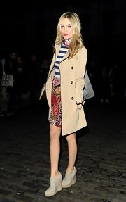 Laura Whitmore teetered on chunky gray wedge boots when she attended the PPQ fashion show.