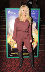 Pamela wore an burgundy jumpsuit with knee high boots and her signature platinum locks.