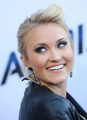 Emily Osment chose lengthy falsies to top off her stunning charcoal eye.