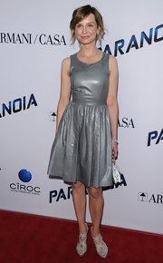 Calista switched up the typical black leather dress by wearing this metallic silver frock.